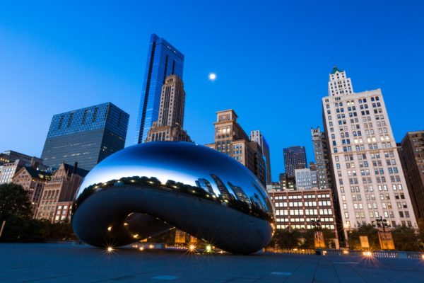 Chicago skyline with the Cloud Gate sculpture in foreground.